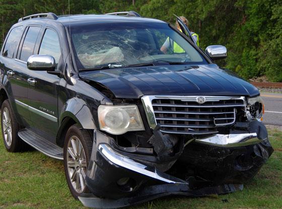 Cars collide sending one into train tracks SUV