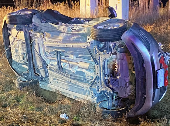 Car flipped on its side in two-vehicle crash